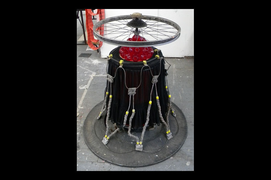 MS. G, found tire chains, tire tread, skirt, assorted hardwear, bicycle wheel, ornaments, wood; 2010