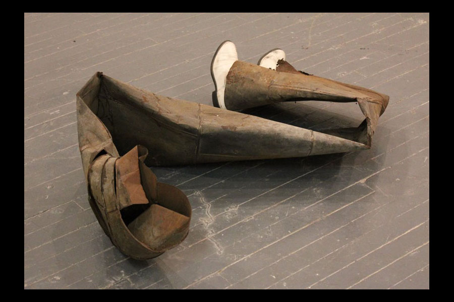 untitled, found pipe, boots, and newspaper, 2010